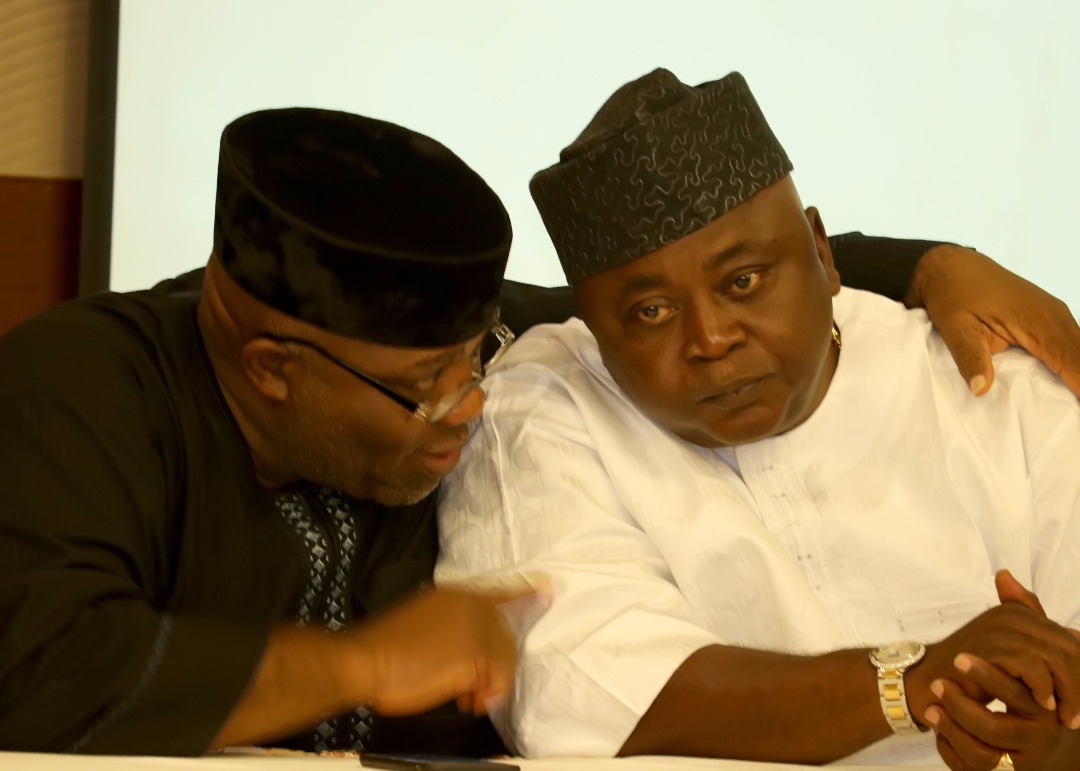Dr Doyin Okupe discusses with Hon Adebutu