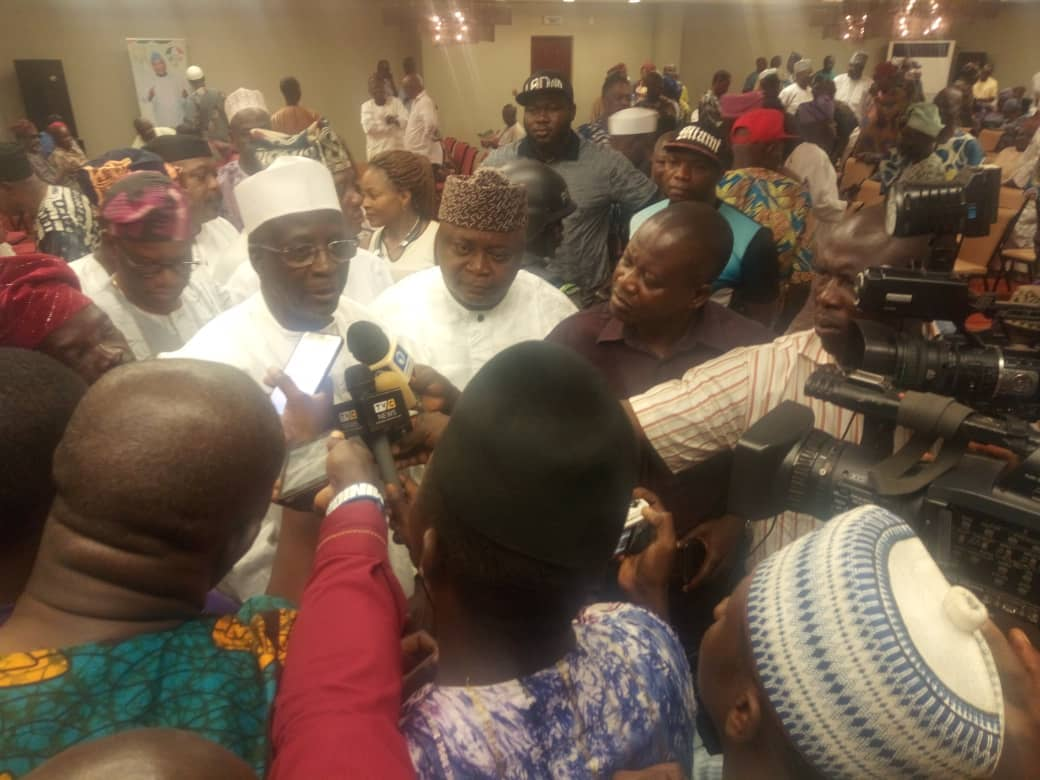 Dr. Bafarawa fielding questions from reporters while Hon Ladi looks on