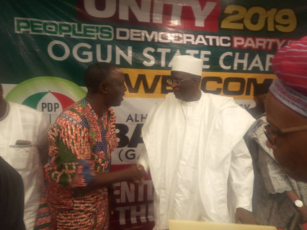 Omooba Sunday Solarin and PDP Presidential hopeful, Dr Attahiru Bafarawa, exchange pleasantries...commended for his efforts