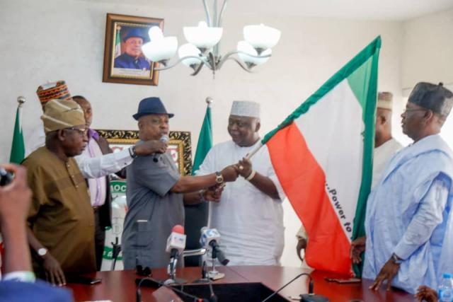 PDP National Chairman Uche Secondus handing over Ogun Governorship Flag to Hon Ladi Adebutu